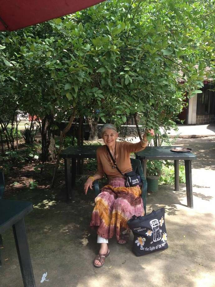 Rusty Holland, New Caney Garden Club president, under a lime tree at the Bora Hotel in Gambela, Africa.
