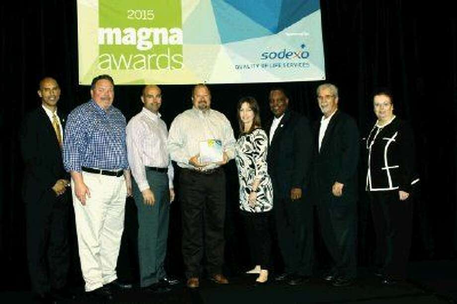 Humble ISD School Board members accept a first place Magna Award for the district's innovative summer camp, Camp Nobis Est. Pictured from left are Steve Dunmore, president of Sodexo-School Services; Brent Engelage, board trustee; Heath Rushing, board trustee; Robert Sitton, board vice president; Angela Conrad, board parliamentarian; Charles Cunningham, board trustee; Dr. Guy Sconzo, superintendent and Marie Bilik, deputy executive director of NSBA. Not pictured are Robert Scarfo, board president and Keith Lapeze, board secretary, who were unable to attend.