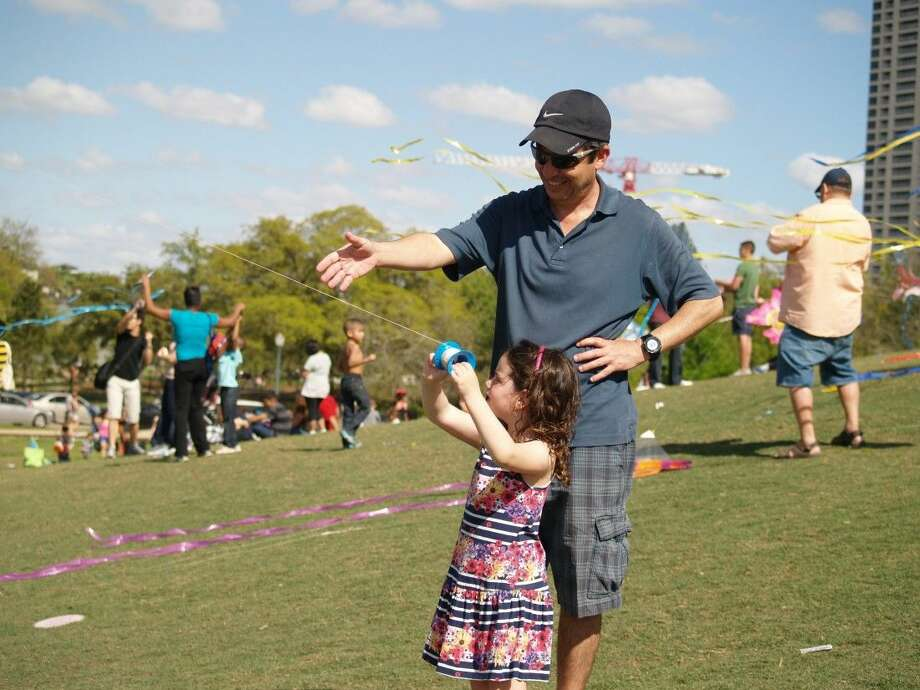 Yoel Waisman and his daughter Keren fly a kite at the Hermann Park Kite Festival on Sunday, March 29th.