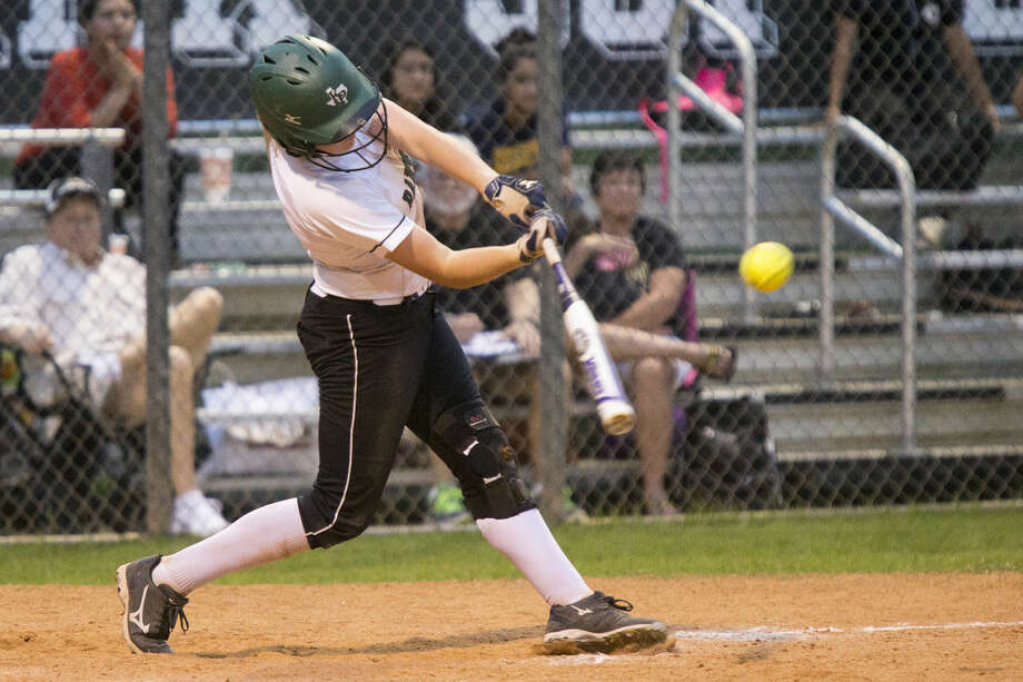 Kendall Searcy (7) hits to right field for the game winning RBI during Kingwood Park's 2-1 victory over Galena Park on March 31, 2015, at Kingwood Park High School.