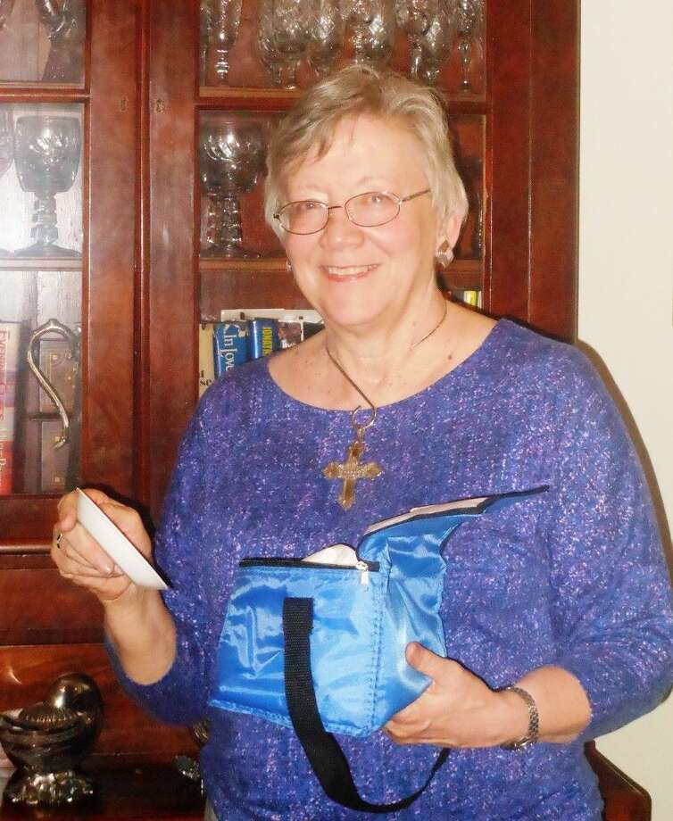Ellen Cook, member of St. Thomas the Apostle Episcopal Church in Nassau Bay, is the new Episcopal Diocese of Texas Altar Guild Directress. She is examining an emergency altar guild kit available to congregations in the diocese.