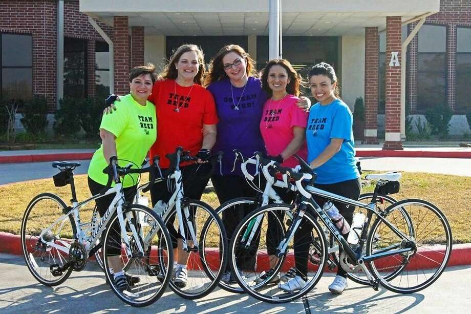 Team Reed prepares to ride in the BP MS 150 and consists of local residents Carolina Moreno is in yellow, Katy Gosling is in red, Michelle Reed is in purple, Cynthia Alonso is in pink and Veatris Grayson is in blue.