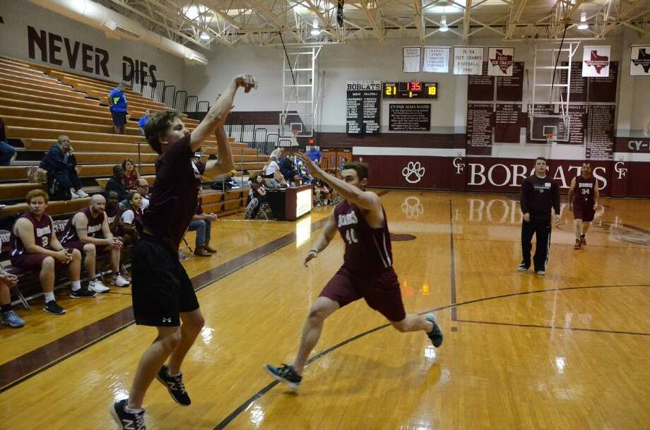 Cy-Fair baseball player Nick Povinelli puts up a shot over a defender the Special Olympics basketball tournament at Cy-Fair High School on March 28.