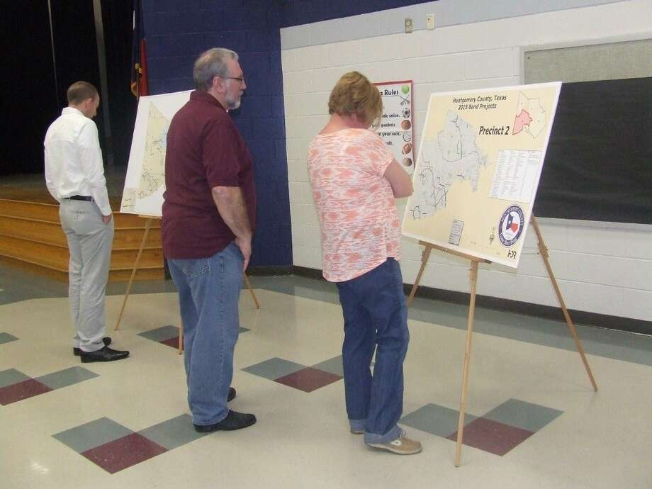 Magnolia residents view the maps of the proposed road projects in the 2015 Montgomery County Road Bond. A forum was held on March 31 at Bear Branch Elementary School in Magnolia. Photo: Lindsey Vaculin