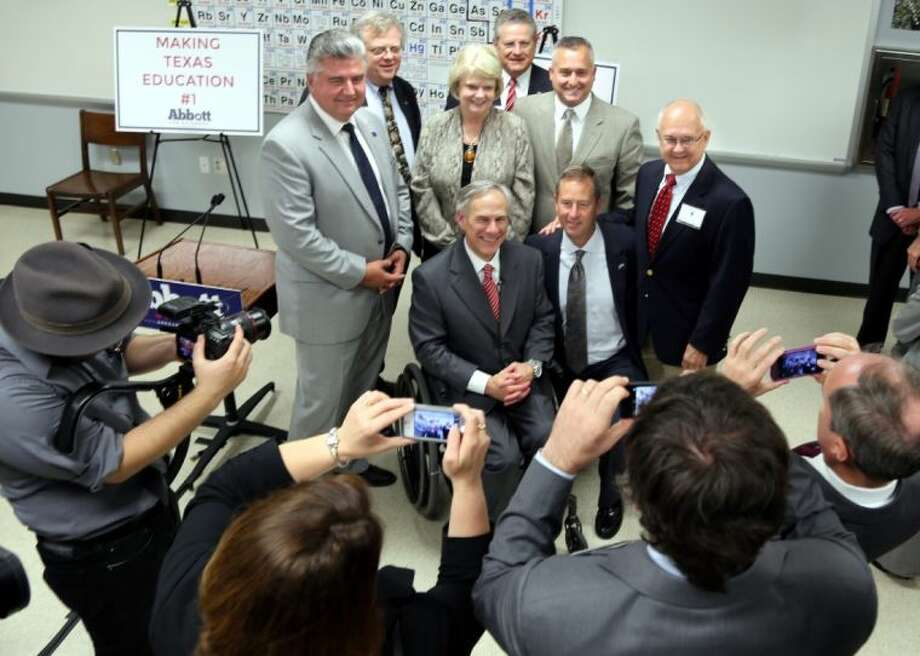 Attorney General Greg Abbott (center) poses with (from left) state Rep. Allen Fletcher (R-130), Republican candidate for District 7 state senator Paul Bettencourt, former Spring Branch ISD trustee Mary Grace Landrum, state Rep. Rick Miller (R-26), state Rep. Dwayne Bohac (R-138) and state Rep. Bill Callegari (R-132). Kneeling beside Abbot is state Rep. Jim Murphy (R-136). Photo: Rusty Graham