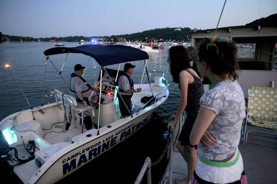 Officials with the Candlewood Lake Marine Patrol make spot safety checks before the annual Candlewood Lake fireworks show on Saturday, June 30, 2012. Photo: Jason Rearick / Jason Rearick / The News-Times