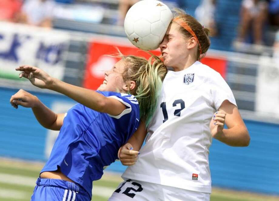 Friendswood's Taylor Rue (left) defends against Wylie East's Sarah O'Neall on a header during the teams' Class 4A state semifinal in Georgetown. Wylie East won the matchup, 4-0. Photo: Staff Photo By Alan Warren