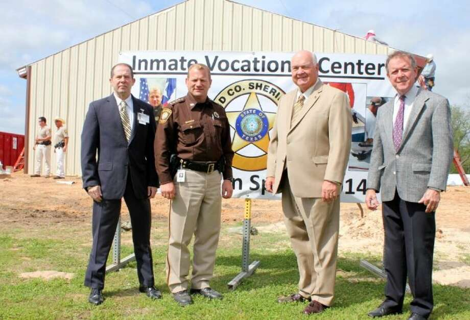 From left, Major Thomas Goodfellow, Detention Bureau commander; Sheriff Troy E. Nehls; County Judge Robert Hebert; and Don Brady, director of Facilities Management and Planning, stand in front of the Inmate Vocational Center being constructed near the Fort Bend County Jail. Photo: Photo Courtesy FBCSO