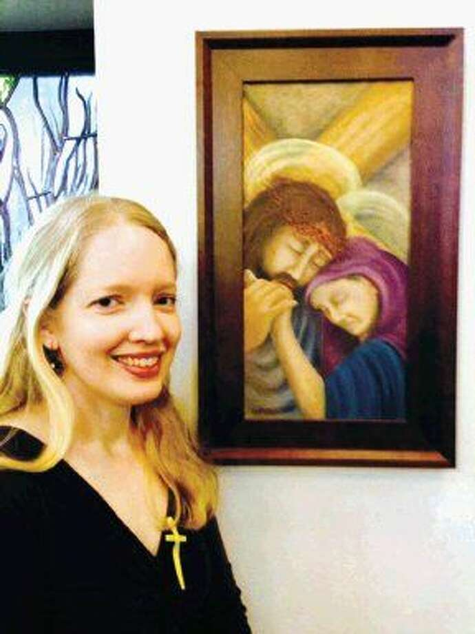 Jessica Dupree with one of the 14 original oil paintings of the Stations of the Cross she created for Good Shepherd Episcopal Church.