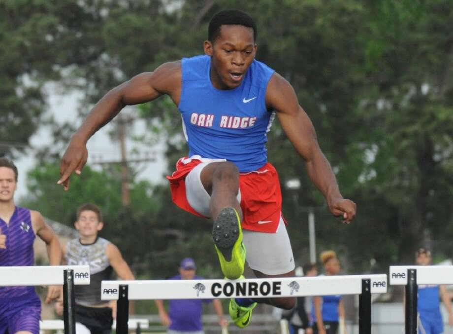 Oak Ridge's Patrick Prince competes in the 300-meter hurdlesat Buddy Moorhead Stadium in Conroe on Thursday.