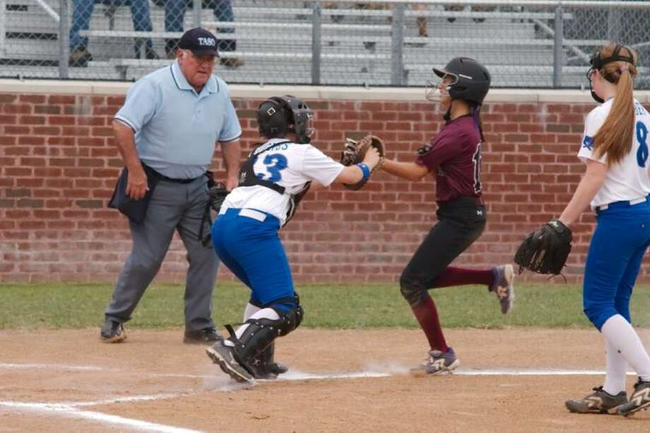 Friendswood's Madison Hughes (23) tags George Ranch's Lulu Nowak out at the plate, but not before she tripled home two runs in the first inning. Photo: KIRK SIDES