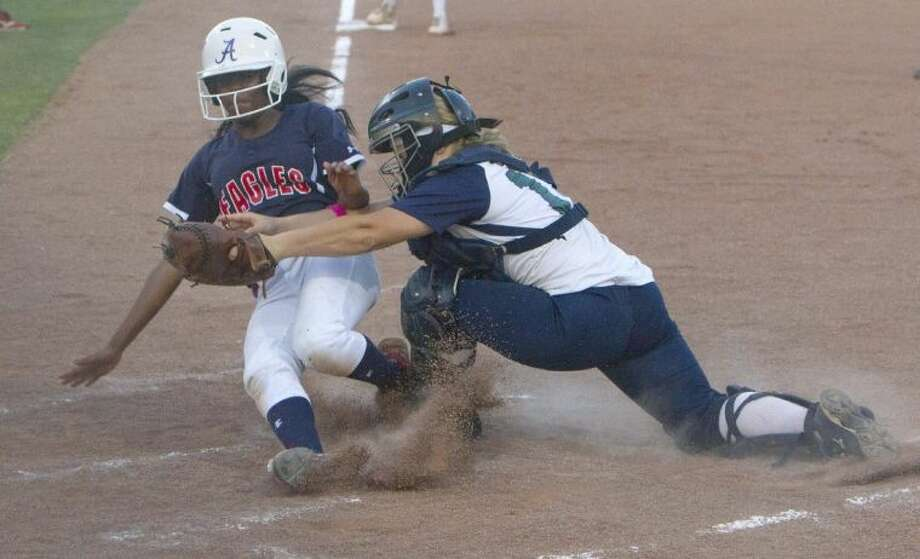 College Park catcher Ally Holland tags out Atascocita's Courtney Nichols at home plate during Game 1 of a high school softball bi-district playoff game Thursday. Atascocita defeated College Park 7-1. To view or purchase this photo and others like it, visit HCNpics.com.