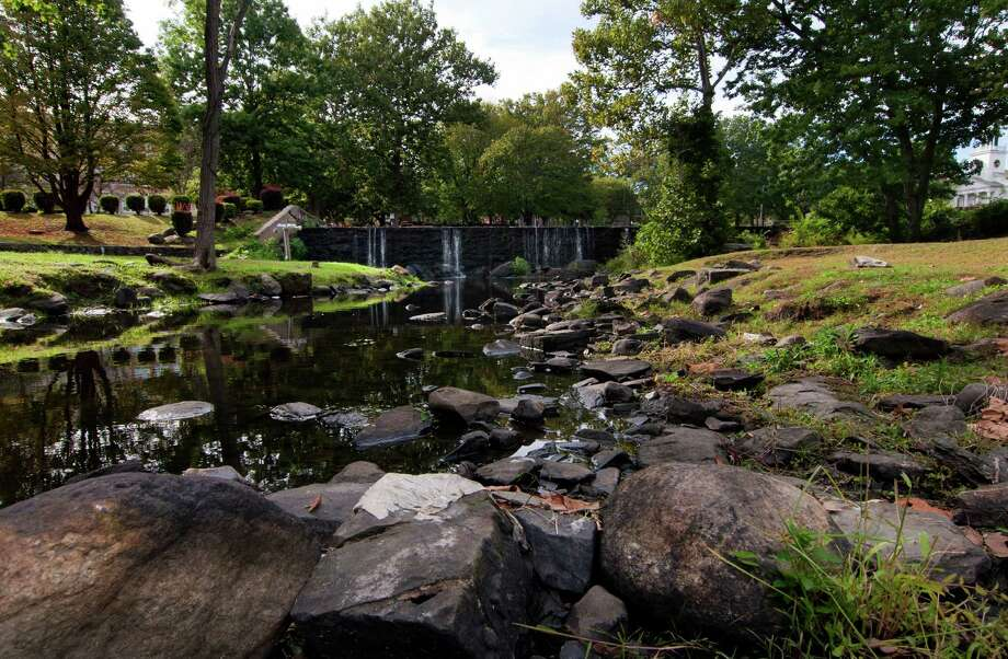 The waterfall behind Milford City Hall is about half of its usual volume due to drought conditions in Milford, Conn., on Tuesday Sept. 27, 2016. Once strong-flowing waterfalls like Southford Falls and the Milford Duck Pond are drying up, power companies are trimming drought-weakened trees and farmers are losing crops. Photo: Christian Abraham / Hearst Connecticut Media / Connecticut Post
