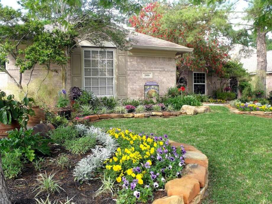 The Kingwood Garden Club is proud to select the lovely yard of Barney and Cecily Ryan as the April Yard-of-the-Month.