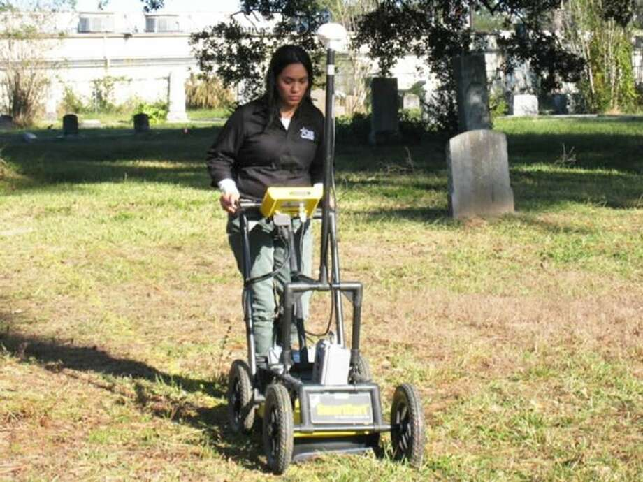 Janet Flores investigates the discrepancy between recorded burials and actual headstones at the Mueschke Cemetery as part of her Lone Star College System Honors College project. Photo: Submitted Photo