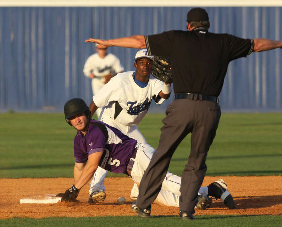 Morton Ranch's Wyatt Reeves slides into second safe against Taylor's Kendrick Holmes during their District 19-5A game April 22 at Taylor High School in Katy. The Mustangs can clinch a playoff spot tonight with a win at Mayde Creek. Visit HCNPics.com for more photos. Photo: Alan Warren/HCN