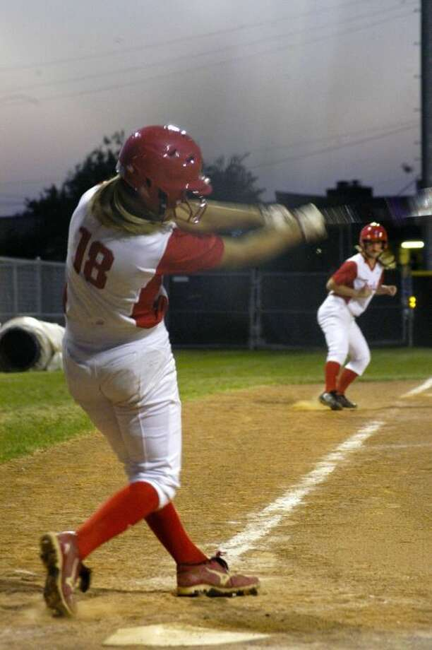 Tomball catcher Lexie Comeaux crushes her second home run of the game in the fourth inning in a 22-0 victory against Austin High School on Thursday, April 24, in the Bi-District round of the 2014 playoffs. (Joshua Koch/HCN)