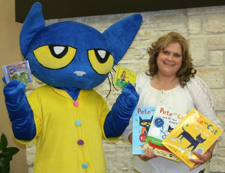 Pete the Cat, star of several best selling children's books, will be visiting Liberty Church on May 10, along with author Eric Litwin. He visited the church on Thursday, April 24, where he was greeted by Laura Roberts, the director of children's ministries, and several children. Photo: STEPHANIE BUCKNER