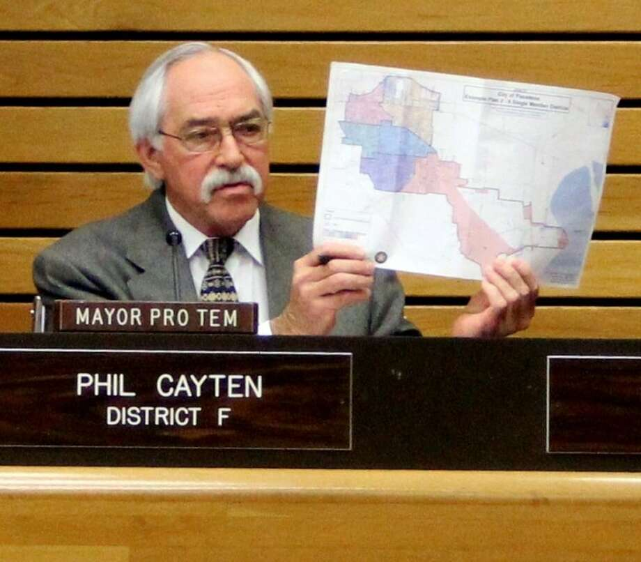 """Pasadena City Councilmember Phil Cayten held up the new city district map during the meeting and voiced his support. """"I'm going to stand by these numbers. If anyone needs to look at these numbers, we have the information. Call the City Secretary and look at the maps yourself."""" Photo: KRISTI NIX"""