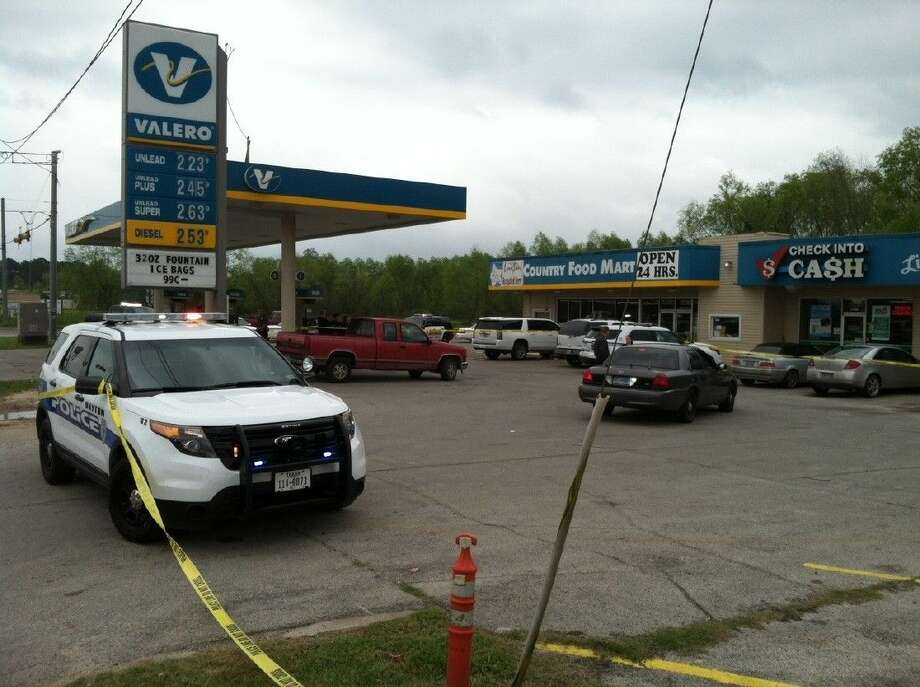 Crime scene tape blocks off the entrances into Valero gas station on US 90 at Main St. in Liberty where an officer-involved shooting took place around 11:30 a.m. Friday. Photo: Casey Stinnett