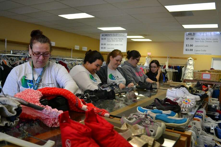 University of Houston-Clear Lake students Stephanie Romero, Diana Perales of Pasadena, Amanda Cox of Friendswood, Ashley Connelley of Friendswood and Julie Garner assisted in sorting garments at local consignment shop, Interfaith Caring Ministries, as a part UH-Clear Lake's annual Day of Service in early March. For more information about Day of Service, visit http://www.uhcl.edu/DayOfService or call the UHCL Student Leadership, Involvement & Community Engagement office, 281-283-2611.