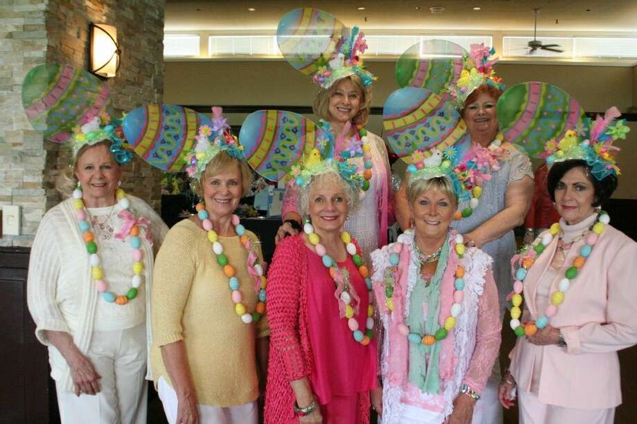 The Easter Bonnet group shows off their unique hats, all ready for the Easter holiday, at the ninth annual Mad Hatter's Luncheon at the Kingwood Country Club April 1, 2015.