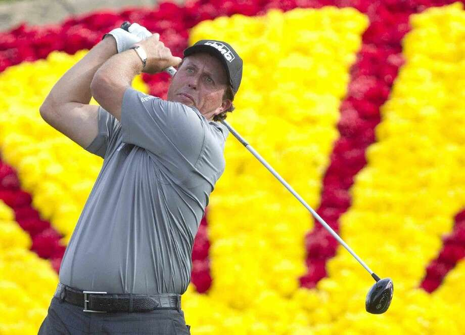 Phil Mickelson hits a tee shot off the 18th tee box during the second round of the Shell Houston Open at the Golf Club of Houston on Friday in Humble.