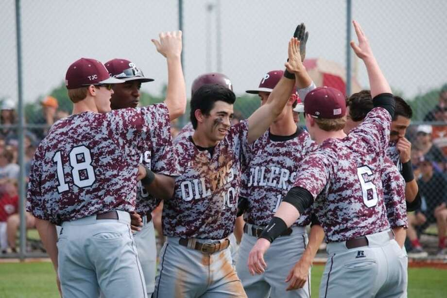 Pearland's Connor Wong (10) is congratulated by teammates after hitting a home run against Dobie Friday. Photo: KIRK SIDES