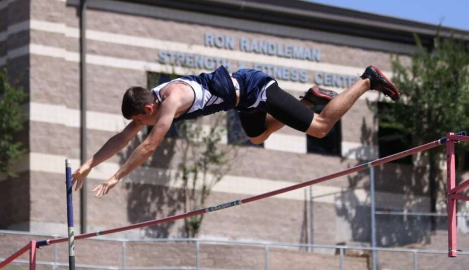 Tomball Memorial pole vaulter Jacob Wooten clears the bar at the Region III-4A Track and Field Championships on Friday in Huntsville.