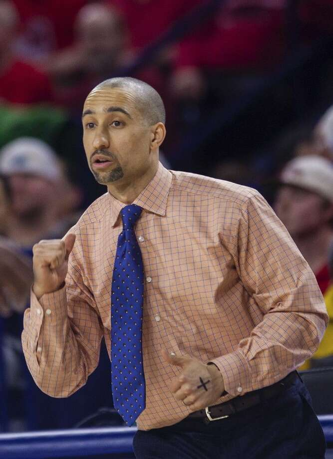 FILE - In this Wednesday, Feb. 25, 2015 file photo, VCU head coach Shaka Smart leads his team during overtime at an NCAA college basketball game at Robins Center in Richmond, Va. Shaka Smart is leaving Virginia Commonwealth to coach the Texas Longhorns. VCU sports information director Scott Day confirmed to reporters gathered at the campus Wednesday night, April 1, 2015 that Smart was making the move. (AP Photo/Zach Gibson, File)
