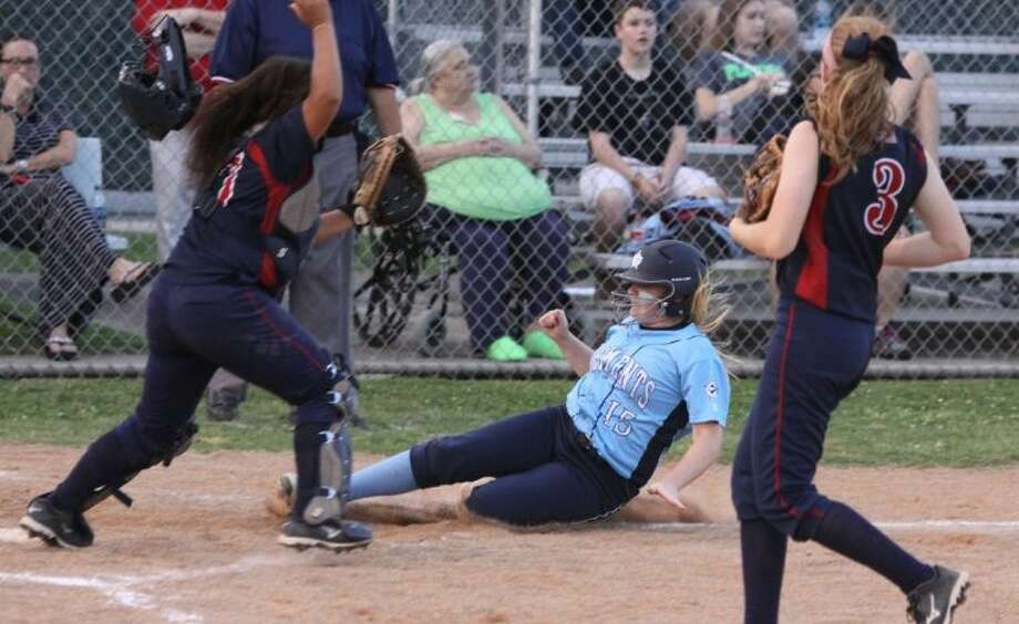 Clements' Addison Goldwait slides in safe at home to score against Clear Lake during their Bi-District Playoff, April 25 at Clements High School in Sugar Land. Visit HCNPics.com for more photos. Photo: Alan Warren