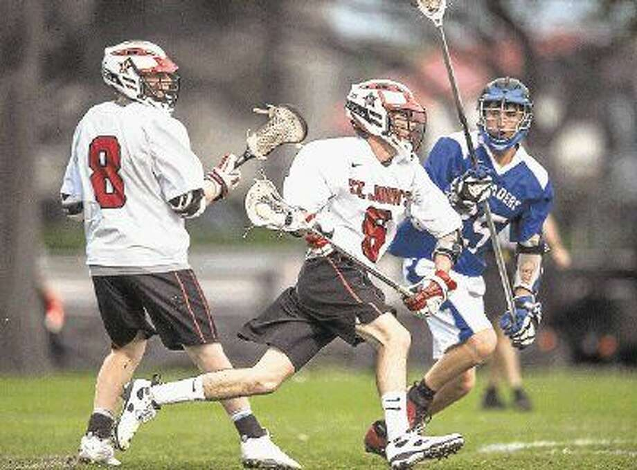St. John's and Episcopal boys lacrosse teams battle it out during the teams' annual SPC matchup last year. St. John's and Episcopal were both hoping to be part of the SPC boys lacrosse tournament, which is scheduled to begin this Friday morning in Austin at St. Andrew's Episcopal School. The teams played just last week with the Mavericks taking a 10-9 triumph over the Knights.