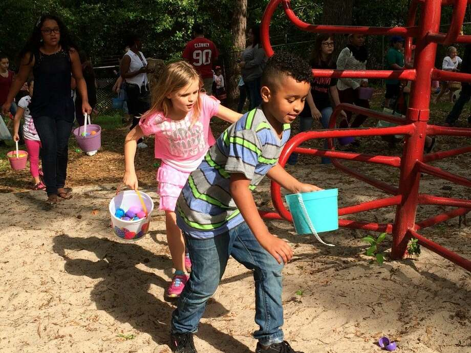 Children scramble to find Easter eggs at the Fourth Annual Bunny Blast on Saturday, April 4, in Cleveland. In addition to gathering some of the 13,000 Easter eggs that were placed around the park, the children had a chance to find golden eggs for prizes. Bunny Blast is one of several annual events hosted each year by the volunteer-driven Unity Committee of Cleveland. Photo: Vanesa Brashier