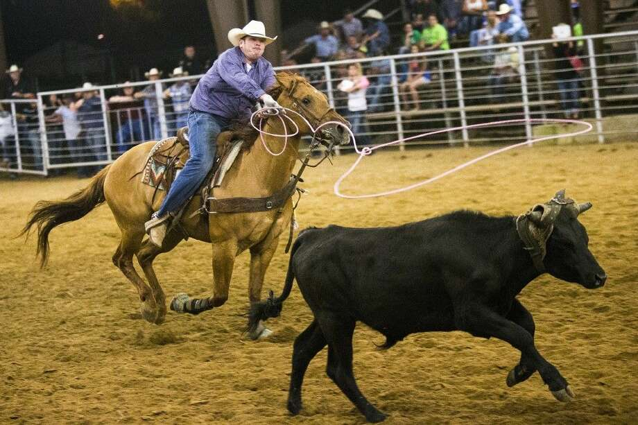 A competitor ropes a calf during the Breakaway Roping competition during the Cleveland Pro Rodeo on May 17, 2014, at the Stancil Expo Center Arena. This year's rodeo comes earlier this year on April 10-11. Photo: Andrew Buckley