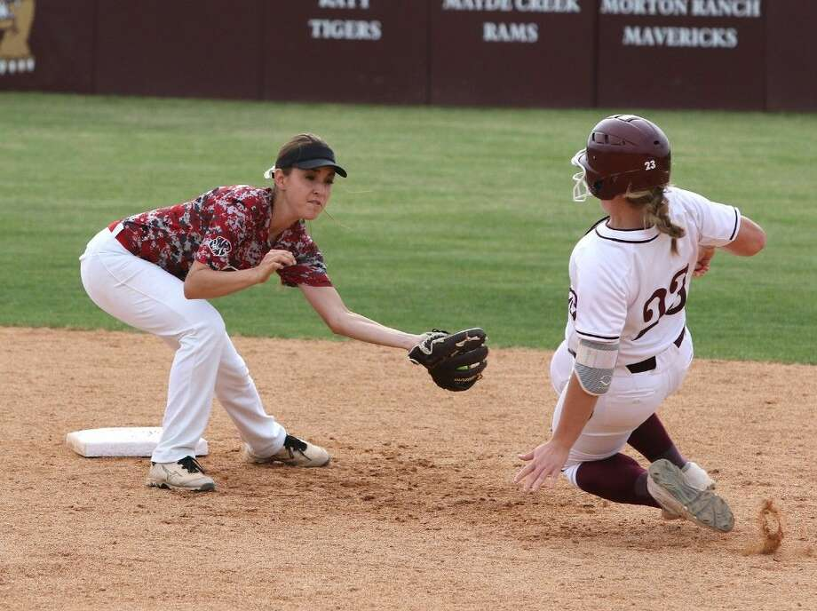 Katy's Emily Hitt gets ready to tag Cinco Ranch's Brittany Nollkamper during their district softball game March 31 at Cinco Ranch High School in Katy. The Lady Tigers defeated Cy-Fair in three games to advance to the Region III-6A semifinals. To view or purchase this photo and others like it, go to HCNPics.com. Photo: Alan Warren