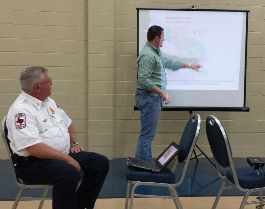ESD #11 President Dusty Payne outlines important points of the Montgomery County ESD merger at the April 25 town hall meeting in Patton Village, as Fire Chief Jeff Taylor looks on.
