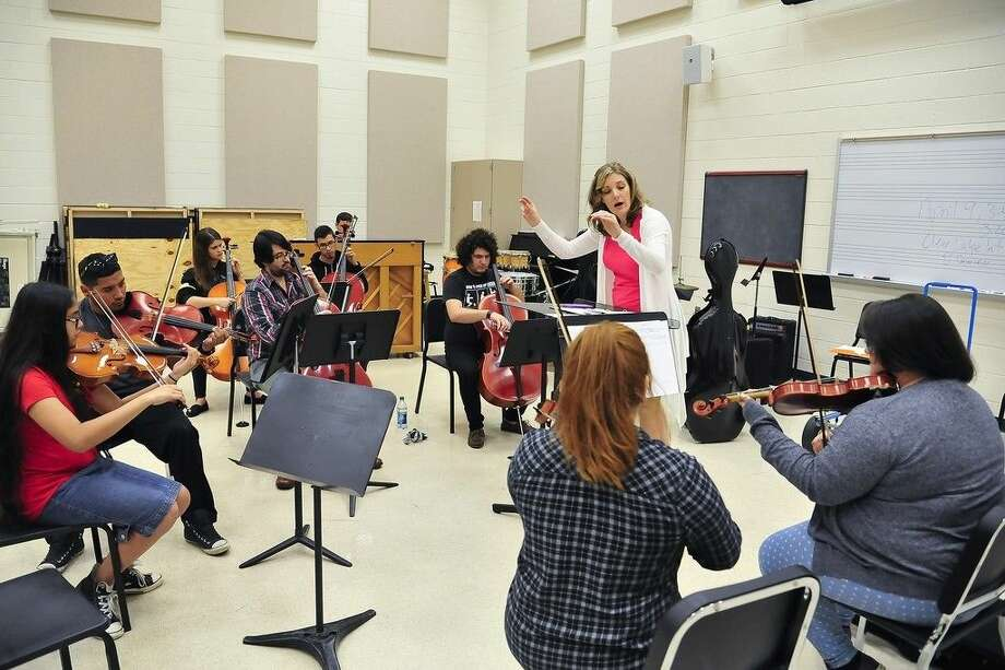 San Jacinto College music professor Lynne Brandt leads orchestra students in rehearsal as they prepare for a chorale and orchestra concert set for April 16. Photo credit: Rob Vanya, San Jacinto College marketing, public relations, and government affairs department.
