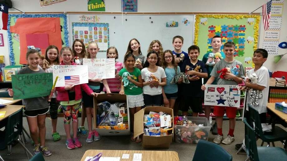 Greentree Elementary fifth grade students collected nearly 300 care package items for troops fighting overseas.
