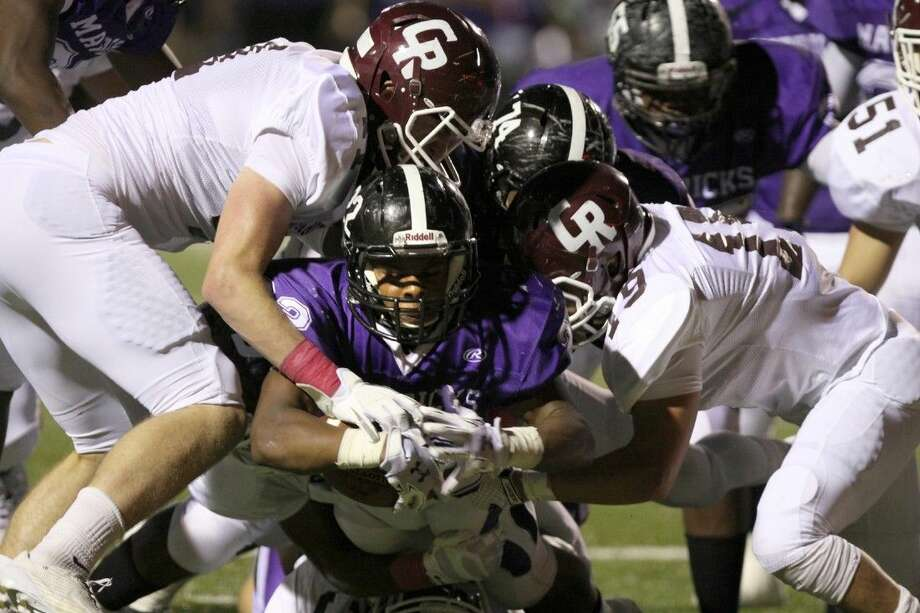 Morton Ranch's Dartavious Dixon dives for extra yardage against Cinco Ranch Oct. 2 at Rhodes Stadium in Katy. To view or purchase this photo and others like it, go to HCNPics.com. Photo: Alan Warren