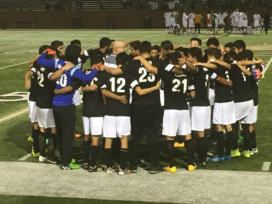 The Cypress Ridge High School boys' soccer team huddles up after winning their Region III-6A area playoff game, 1-0, on April 2 at Rhodes Stadium in Katy. The Rams will face Aldine High School in the regional quarterfinal on April 7.