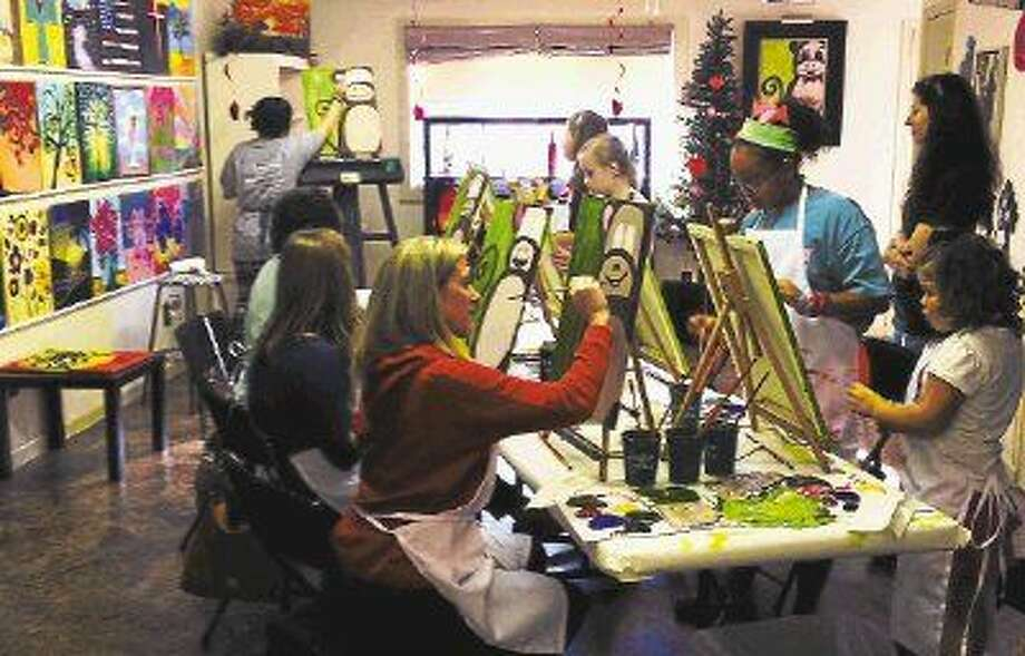 Patrons enjoy a nice painting session at Easel Street, located at 205 N. Sycamore St. in Tomball. The studio opened up last October.