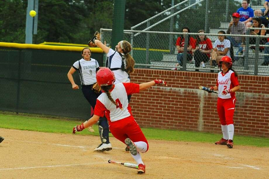 Tomball's Katherine Thompson slides into home plate scoring a run. Thompson scored twice in the Cougars 4-0 victory. Photo: Tony Gaines