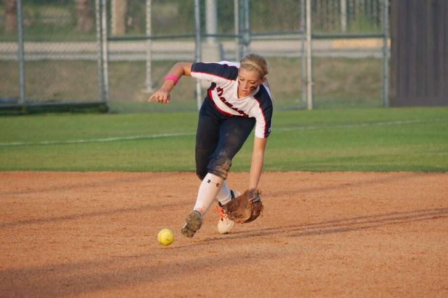 Dawson's Rose Sullivan (5) fields a ground ball against Richmond Foster Friday. Sullivan had three hits Saturday in helping lead the Lady Eagles to a victory in their best-of-three series. Photo: KIRK SIDES