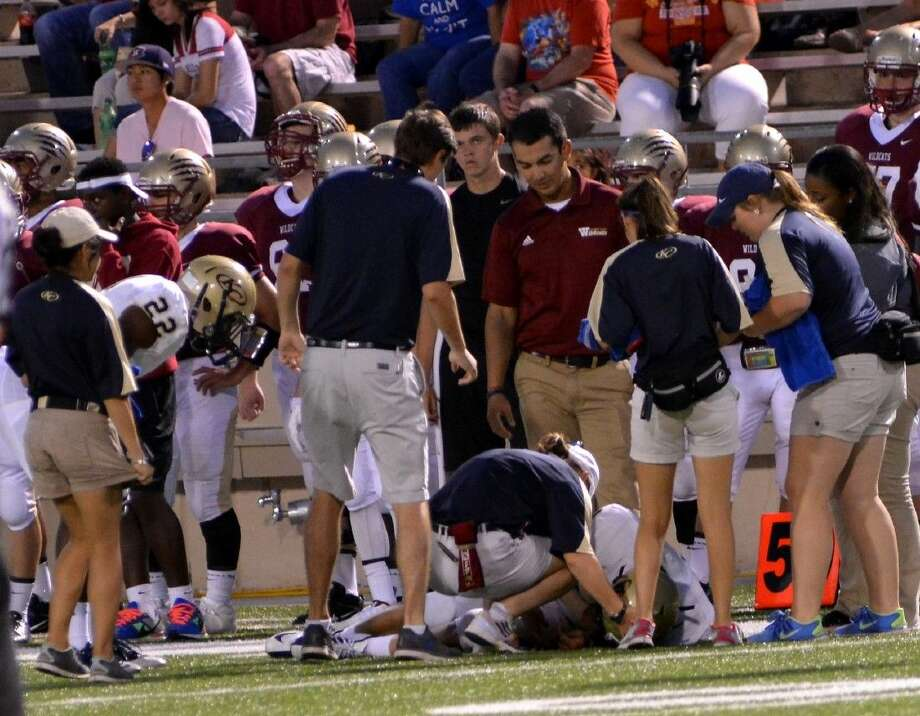 Student trainers assist Klein Collins Athletic Trainer as they tend to a football player on the field. Photo: Courtesy Photo