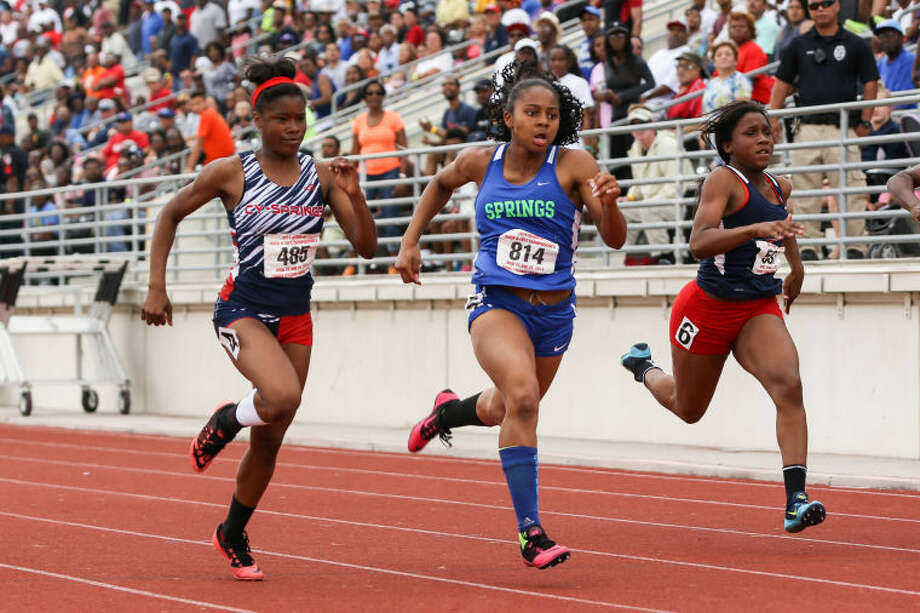 Cypress Springs' Essance Sample, left, battles for first place with Clear Springs' Thai Williams, right, in the girls' 100 meter dash during the Region III 3A and 5A Track Championships on Saturday, April 26, 2014, at Turner Stadium in Humble. To view or purchase this photo and others like it, go to HCNPics.com.