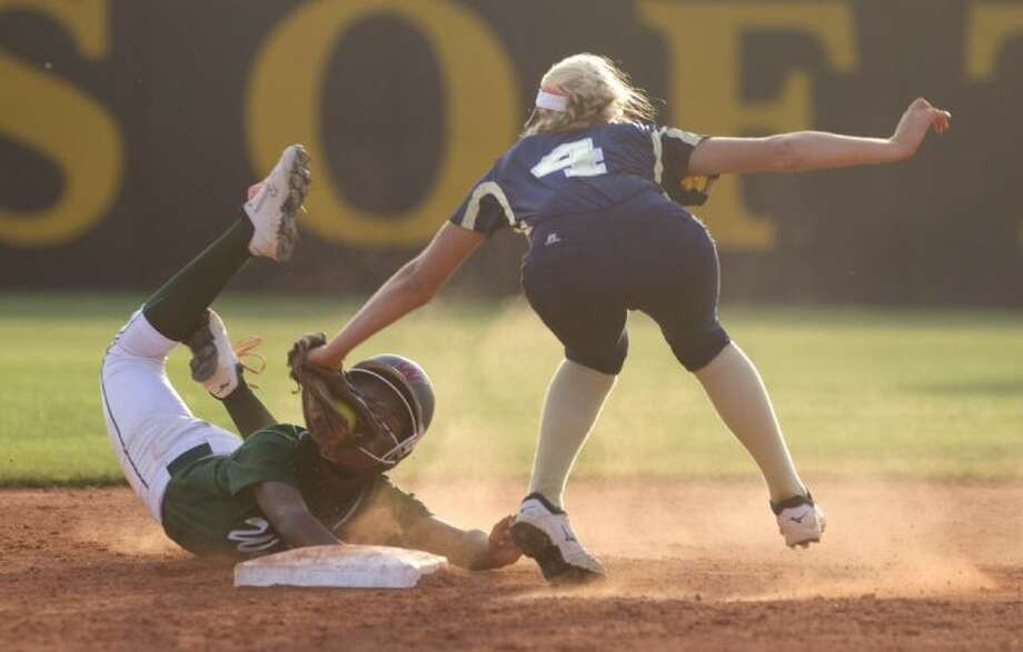 The Woodlands' Kayla McCallum beats a tag by Klein Collins shortstop Demi Janak during Game 2 of a bi-district playoff series on Saturday at Klein Oak High School. To view or purchase this photo and others like it, visit HCNpics.com.