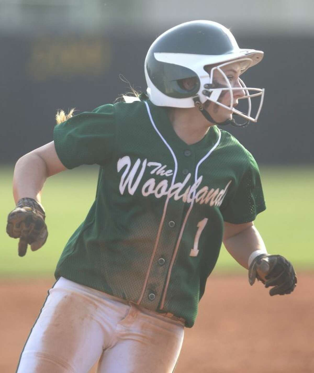 The Woodlands' Aubrey Leach watches a play at first after rounding third base during Game 2 of a bi-district playoff series against Klein Collins on Saturday at Klein Oak High School. To view or purchase this photo and others like it, visit HCNpics.com.