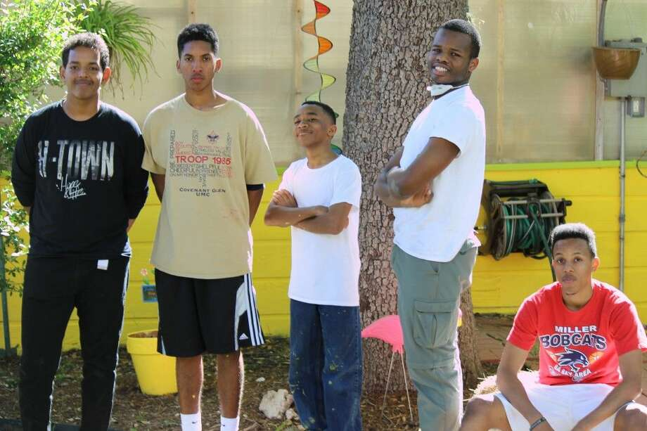 Caleb Tewolde, Eagle Scout candidate Justin Campbell, Shannon Norwood, Malik Wright and Philip Prater take a break from cleaning up and painting the greenhouse at TIRR Memorial Hermann.