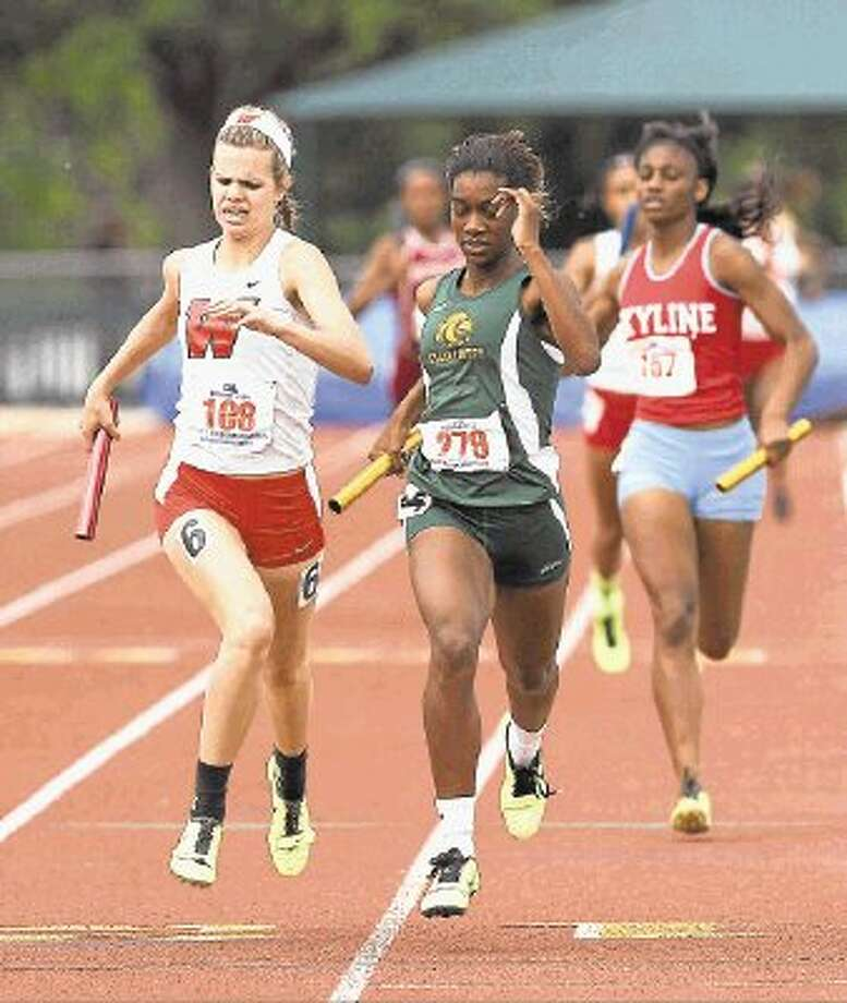 The Woodlands' Kaitlynn Lindsey competes in the 1,600 relay last season. The Woodlands quartet of Kendall Curzan, Lindsay Wilken, Charity Thomas and Lindsey won the 1,600 relay in the Region II-5A meet on Saturday, completing the Lady Highlanders' team championship at Baylor University. / @WireImgId=2624912