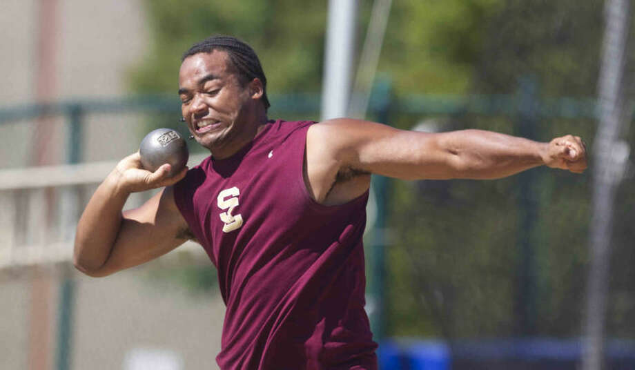 Summer Creek's Dakota Allen competes in the boys shot-put during the Region III-4A track and field championships in Huntsville Friday.  Photo: Jason Fochtman